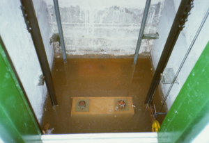 seal-lift-well-before, Waterproofing Lift Wells